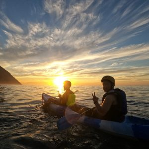 sunrise kayaking at the pacific ocean