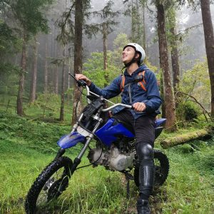 Sitting on motocross and enjoying greenshower in ruisui forest